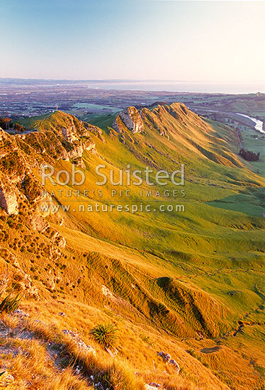 Sunrise on Te Mata Peak (399m). Overlooking Hawke Bay and the Tukituki River, Hawke's Bay, Hastings District, Hawke's Bay Region, New Zealand (NZ) stock photo.