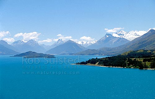 Lake Wakatipu. Pigeon and Pig Islands; Rees and Dart Rivers at head. Mount (Mt) Earnslaw (2816m-right), Glenorchy, Queenstown Lakes District, Otago Region, New Zealand (NZ) stock photo.