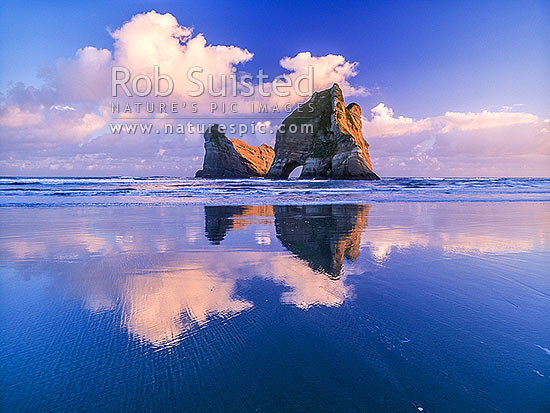 The Archway Islands on Wharariki Beach; Puponga Farm Park, Farewell Spit, Golden Bay, Tasman District, Tasman Region, New Zealand (NZ) stock photo.