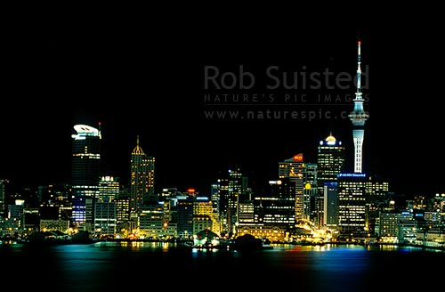 Auckland city-scape and harbour at night showing Sky tower, Auckland City, Auckland City District, Auckland Region, New Zealand (NZ) stock photo.