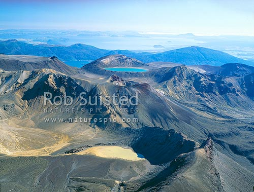 View over Mount (Mt) Tongariro, south crater and blue lake from the summit of Mount (Mt). Ngauruhoe, Tongariro National Park, Taupo District, Waikato Region, New Zealand (NZ) stock photo.