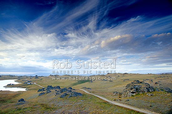 Evening at Poolburn Reservoir in Rough Ridge, Poolburn, Central Otago District, Otago Region, New Zealand (NZ) stock photo.