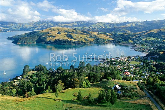Looking down over French Bay and the town of Akaroa; Akaroa Harbour, Akaroa, Banks Peninsula District, Canterbury Region, New Zealand (NZ) stock photo.