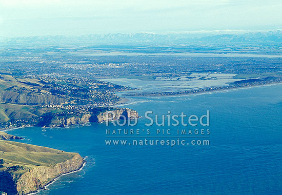 Overlooking Sumner Head and Heathcote/Avon Estuary to Christchurch City and beyond to the Southern Alps, Christchurch, Christchurch City District, Canterbury Region, New Zealand (NZ) stock photo.