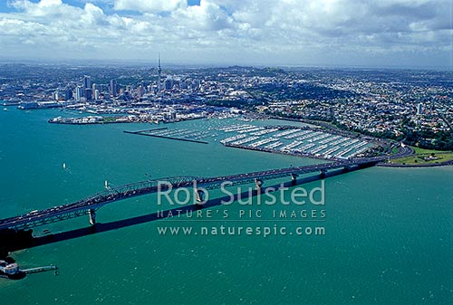 The Auckland Harbour bridge, Westhaven Marina, Downtown and the Sky tower from the air, Auckland, Auckland City District, Auckland Region, New Zealand (NZ) stock photo.