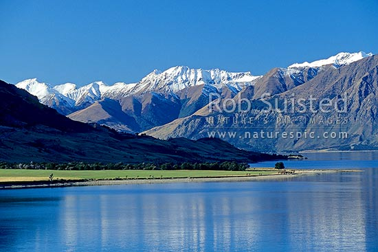 Snowy peaks above Lake Hawea and the Dingle Burn, Wanaka, Queenstown Lakes District, Otago Region, New Zealand (NZ) stock photo.