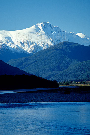 Mount (Mt) Hooker (2652m) above the Landsborough River, in winter, Haast, Westland District, West Coast Region, New Zealand (NZ) stock photo.