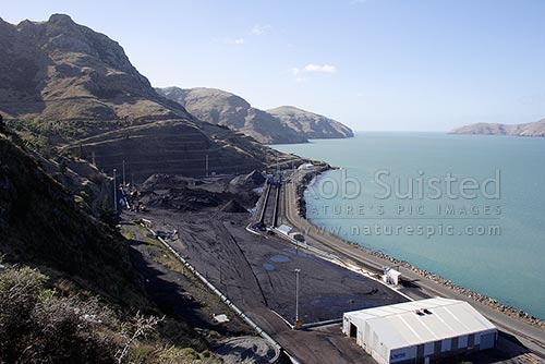 Bulk coal storage ready to be loaded into ships at Lyttelton Harbour for export, Lyttelton Harbour, Banks Peninsula District, Canterbury Region, New Zealand (NZ) stock photo.