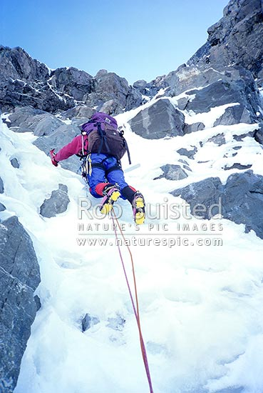 Mountaineer / climber on the South Face of Mount (Mt) Cook / Aoraki. PHOTO BY: Phil Suisted, Aoraki / Mount Cook National Park, MacKenzie District, Canterbury Region, New Zealand (NZ) stock photo.