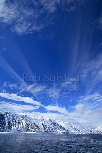 Cloud patterns above Cape Adare and Robertson Bay. Admiralty Mountains distant, Ross Sea. Victoria Land, Cape Adare, Ross Sea, Antarctica District, Antarctica Region, Antarctica stock photo.