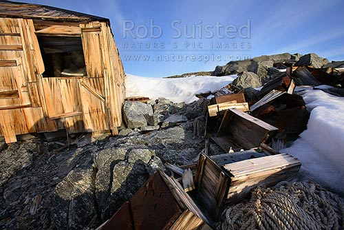 Artefact scatter of store crates behind the Historic 1912-14 Mawson's hut, Cape Denison -'Home of the Blizzard', Commonwealth Bay, George V Land, Antarctica District, Antarctica Region, Antarctica stock photo.