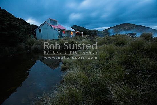 Sunset at Sunrise Hut, tramping hut in the Ruahine Ranges. Long exposure, Ruahine Forest Park, Central Hawke's Bay District, Hawke's Bay Region, New Zealand (NZ) stock photo.