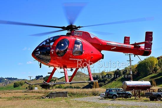 Helicopter lift off at Wanganui Aeroworks - Brian Goodwin pilot. MD-520N McDonnell Douglas (Hughes), Taihape, New Zealand (NZ) stock photo.