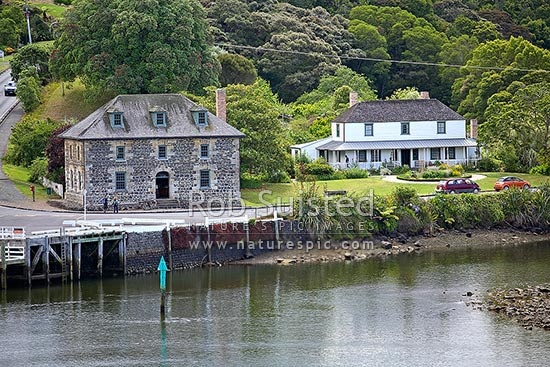 Historic Stone Store (1832) and Mission Station Kemp House (1821-right) next to the Kerikeri Inlet Basin, Kerikeri, Far North District, Northland Region, New Zealand (NZ) stock photo.