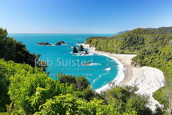 Looking north along remote South Westland Coast from Knights Point over Murphy Beach, Herring Stream and rocky outcrops. Rainforest cloaked headlands, Haast, Westland District, West Coast Region, New Zealand (NZ) stock photo.