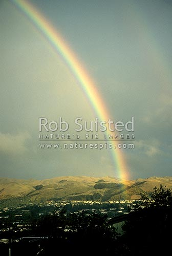 Rainbow over hills of Tawa, Wellington, Wellington City District, Wellington Region, New Zealand (NZ) stock photo.