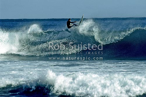 Surfing waves, Wellington, New Zealand (NZ) stock photo.