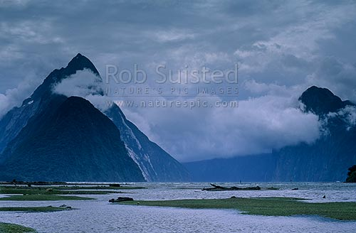 Mitre Peak (1683m) left, and The Lion (1307m) at right. Stormy weather, Milford Sound, Fiordland National Park, Southland District, Southland Region, New Zealand (NZ) stock photo.