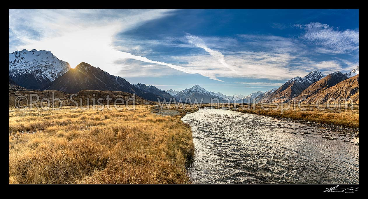 Image of Tasman Valley sunset, with Aoraki Mt Cook (3754m) centre above clear mountain stream. Ben Ohau Range left, and Burnett Mountains right. Panorama, Aoraki / Mount Cook National Park, MacKenzie District, Canterbury Region, New Zealand (NZ) stock photo image