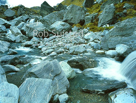 Alpine creek above Lake Douglas. Karangarua River Valley, Douglas River, Westland District, West Coast Region, New Zealand (NZ) stock photo.