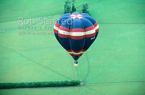 Hot air balloon over the Wairarapa countryside, Carterton, Carterton District, Wellington Region, New Zealand (NZ) stock photo.